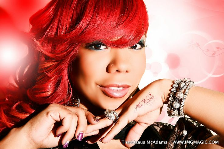 Tameka Cottle Red Weave Hairstyle