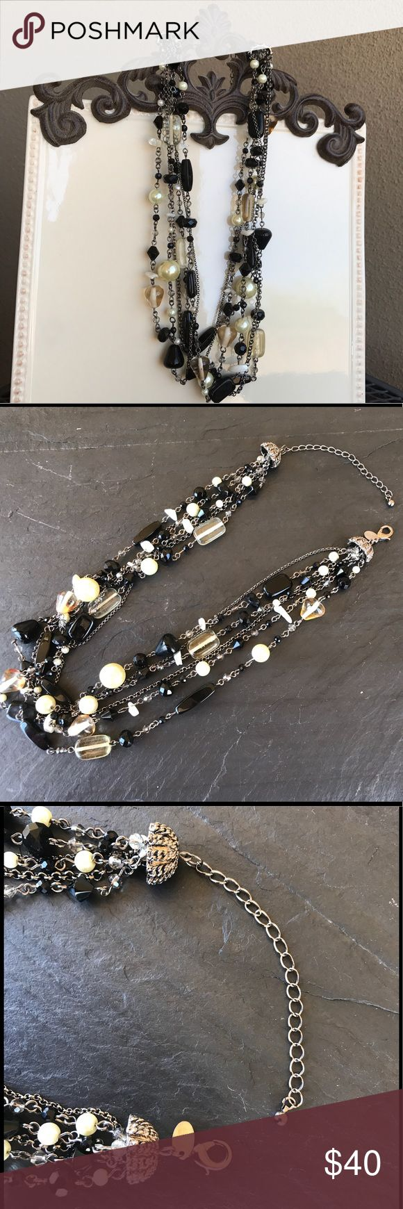 Lia Sophia six strand Necklace Lia Sophia Necklace wi/black and glass beads along with  crystal and pearls. I purchased at a Lia Sophia party years ago. Hangs beautifully! Lia Sophia Jewelry Necklaces