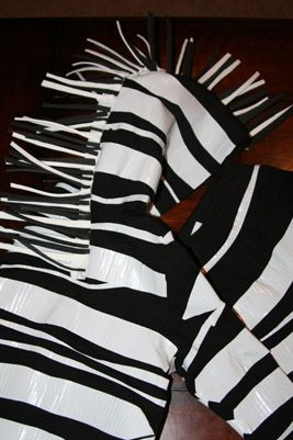 DIY zebra costume. Use leggings and black t shirts instead of sweatsuit