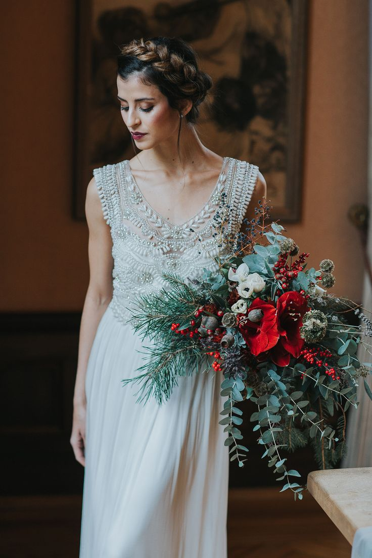 Anna Campbell Bridal   Madison Dress   Vintage-inspired hand embellished wedding dress   Red and green bridal bouquet   Photography Cornelia Lietz
