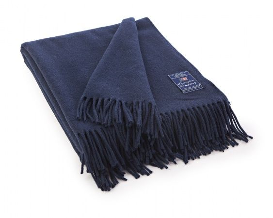 Lexington icons solid wool throw with fringes at edge. A bit of softness for your home!