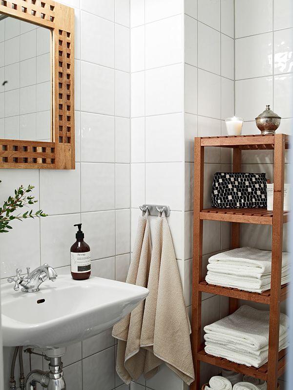 How To Decorate A Small Apartment Bathroom: Beautiful One Room Apartment  Bathroom With A Mirror And White Wall And White Water Tap And A Brown Towel  ...