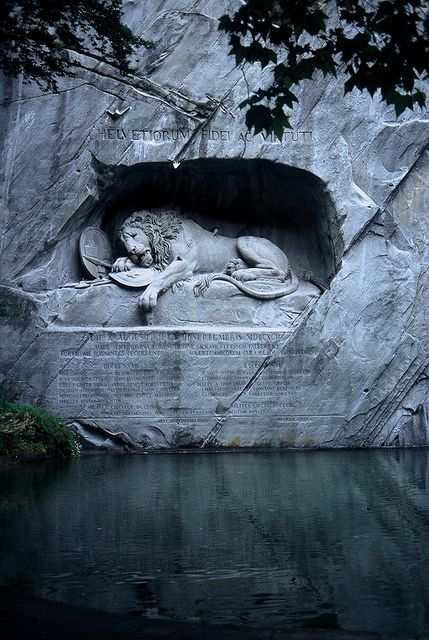 """The Lion Monument, or the Lion of Lucerne, is a sculpture in Lucerne, Switzerland, designed by Bertel Thorvaldsen and hewn in 1820–21 by Lukas Ahorn. It commemorates the Swiss Guards who were massacred in 1792 during the French Revolution, when revolutionaries stormed the Tuileries Palace in Paris,France. The American writer Mark Twain (1835–1910) praised the sculpture of a mortally-wounded lion as """"the most mournful and moving piece of stone in the world."""" [via]"""