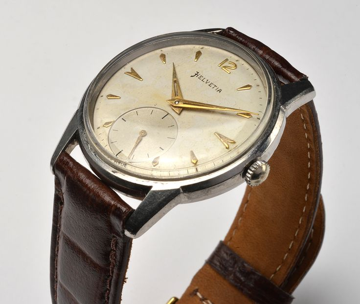 Helvetia  For Sale , Beautiful vintage watch  1950s 60s watch Antimagnetic Stainless Steel ,Swiss made, waterproof incabloc  Movement:  winding   Case Size:  33.7mm with crown   Works fine, just cleaned