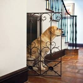 dog house under stairs. so much better than a dog crate!