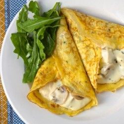 Chicken and Mushroom Crepes - Batter 8 oz milk 4 eggs 1 scant c flour 1/2 t kosher salt 2 T finely snipped fresh chives Filling 10-12oz chicken breast 3/4 c chicken stock 1 T unsalted butter  6 oz small button mushrooms, sliced Freshly squeezed juice of 1/2 a small lemon Kosher salt and white pepper 1 T finely chopped fresh tarragon leaves  (or 2-3 T chopped fresh parsley) Mornay sauce - 2T unsalted butter 2T flour 2c milk Salt and pepper 2 egg yolks 3oz Gruyere