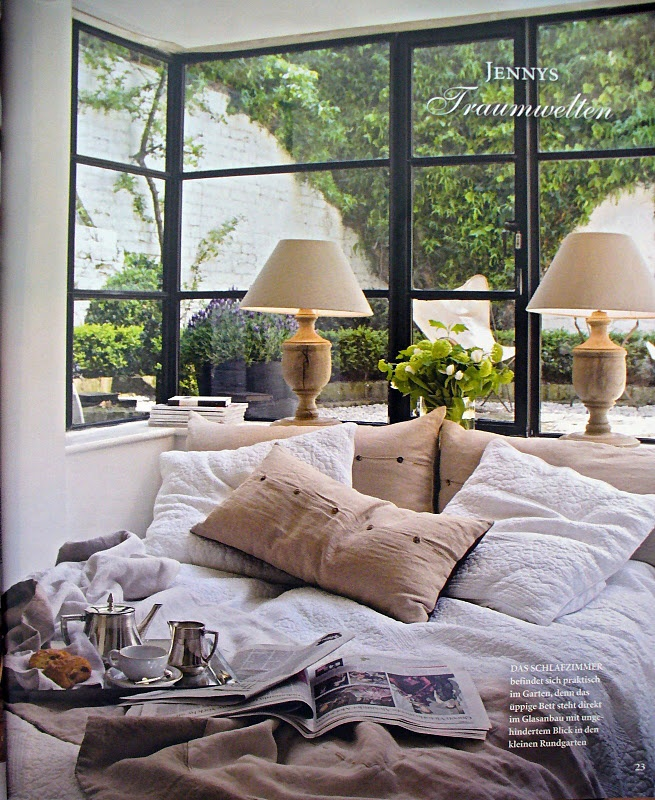 Pretty sure I would lay in bed and reach all day . . . Corner window daybed w/ lamps on the sill