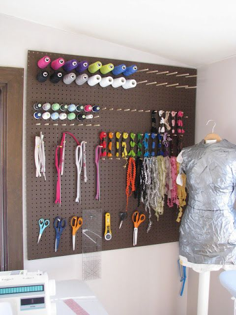 pegboard craft room storage...cheap and easy and can be any color you want...with a little paint.
