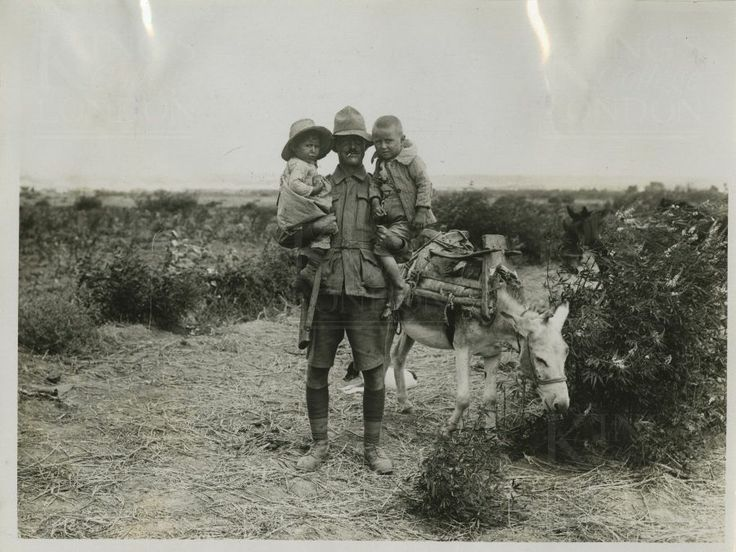 Photograph of an ANZAC soldier carrying two Turkish children. No 3128. From a collection of official photographs of the Dardanelles Expedition, 1915.