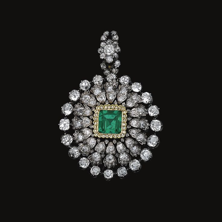 PROPERTY OF A EUROPEAN NOBLE FAMILY: Emerald and diamond pendant/brooch, mid 19th century. Of circular form, set at the centre with a cushion-shaped 4.50 carat natural Colombian emerald within a scalloped frame of rose diamonds, further decorated with cushion-shaped and circular-cut stones.