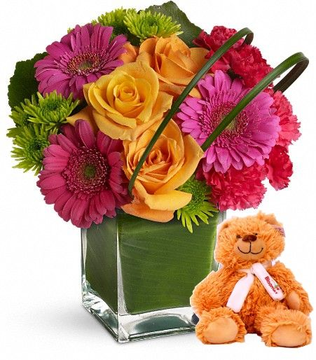 Teddy Bear Bouquet: Included in this exceptional bouquet are gerberas, carnations, and elegant roses, complimented with fresh greens and an adorable teddy bear.
