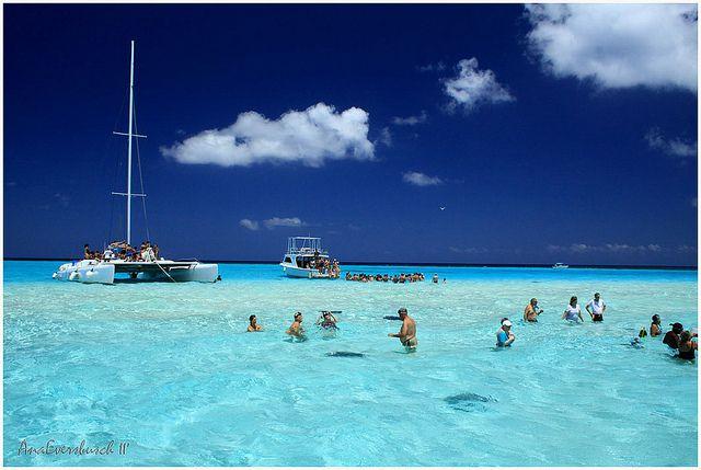 Stingray City Grand Cayman Islands- sandbar miles off shore- stingrays everywhere!  The kids were afraid, but I swam with the stingrays!