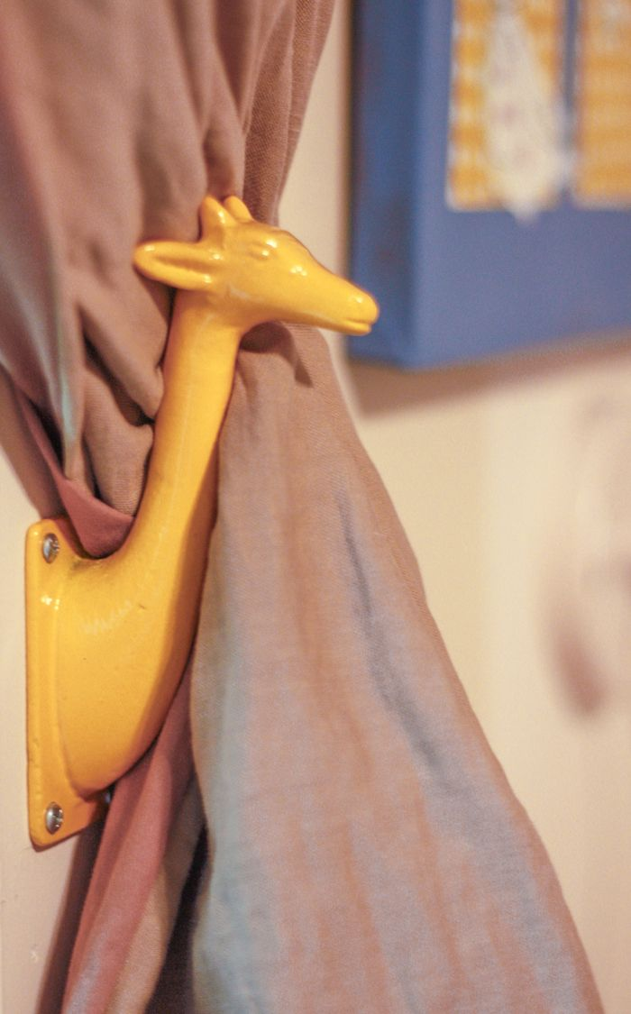 One Little Minute - http://www.onelittleminuteblog.com/2012/07/home-away-from-home-yellow-giraffe-curtain-holdbacks/