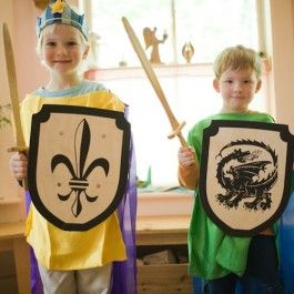 Silk knight's costumes, wooden swords and shields, blue felt crown. From Bella Luna Toys.