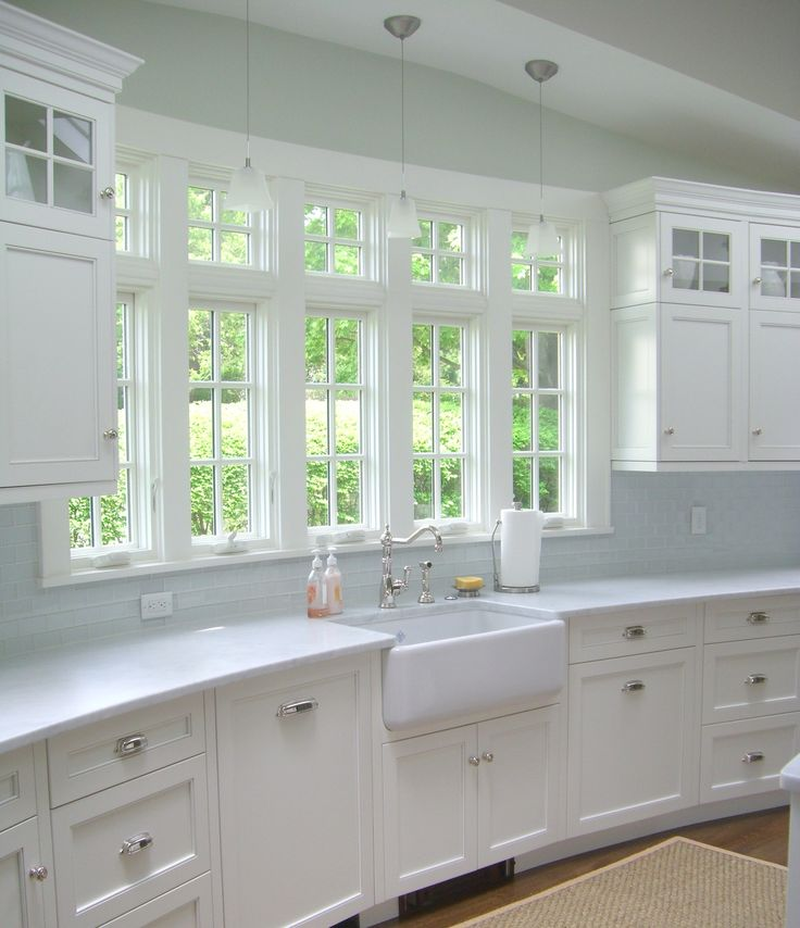 Love the windows and farmhouse sink. Not so much on the backsplash. Window looks into backyard garden