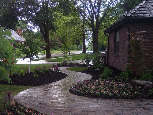 Front stone walkway and landscaping in omaha nebraska for Residential landscaping ideas