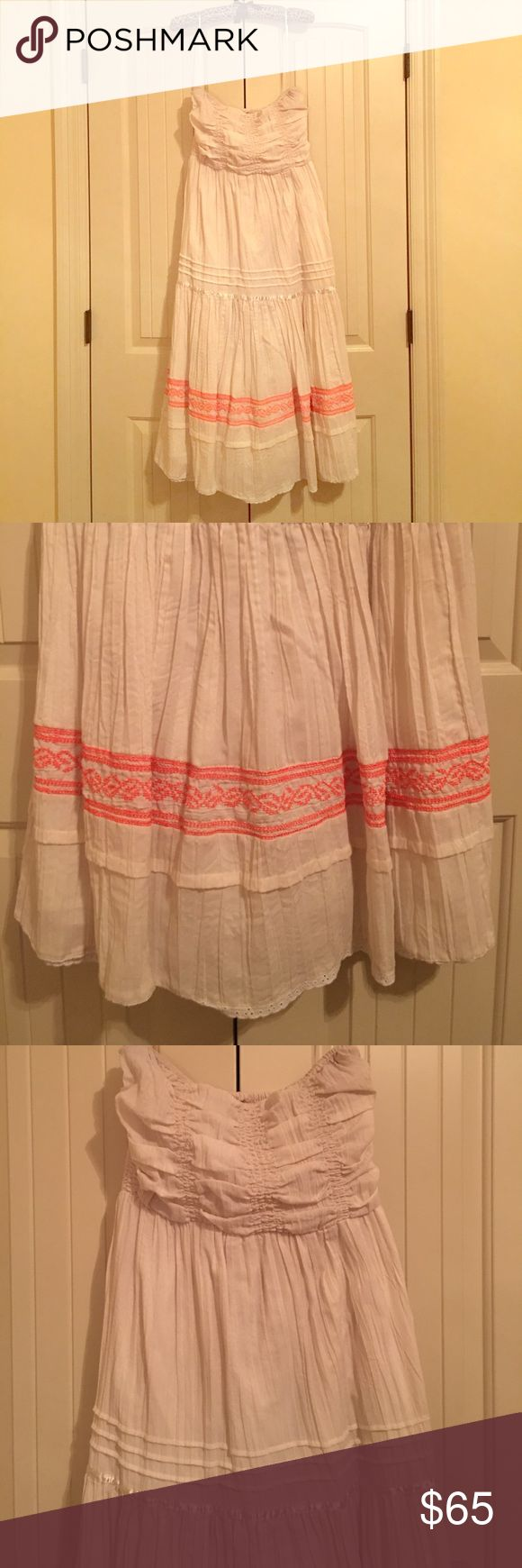 Free People strapless peasant dress - SUMMER MUST! Free People Peasant Dress. Size Medium. Great condition. Ivory colored with neon orange embroidery near bottom. Has slip underneath so not see through. ☀️ Super comfy summer dress to wear over a swimsuit or to a party with wedges! 💖. Exterior shell is 65% polyester and 35% cotton. The inner slip is 100% cotton. Free People Dresses Strapless