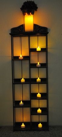 Old CD tower rack re-purposed for holding candles