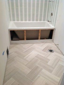 Herringbone floor in a 12x24 porcelain tile for the mud room