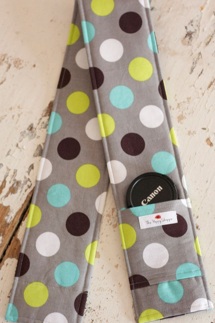 DSLR Camera Strap Cover- lens cap pocket and padding included- Splendid Dot. $14.00, via Etsy.