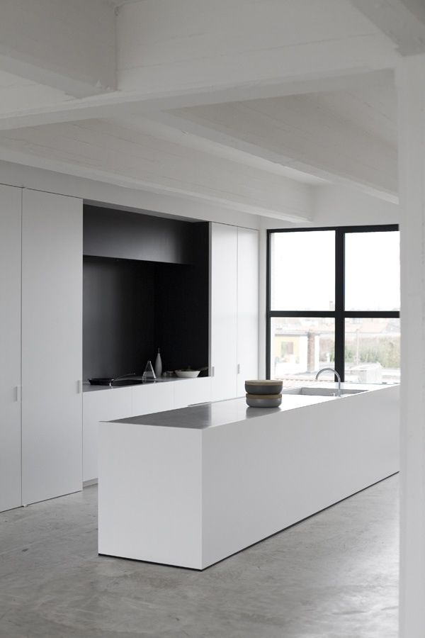 white kitchen + concrete floors.