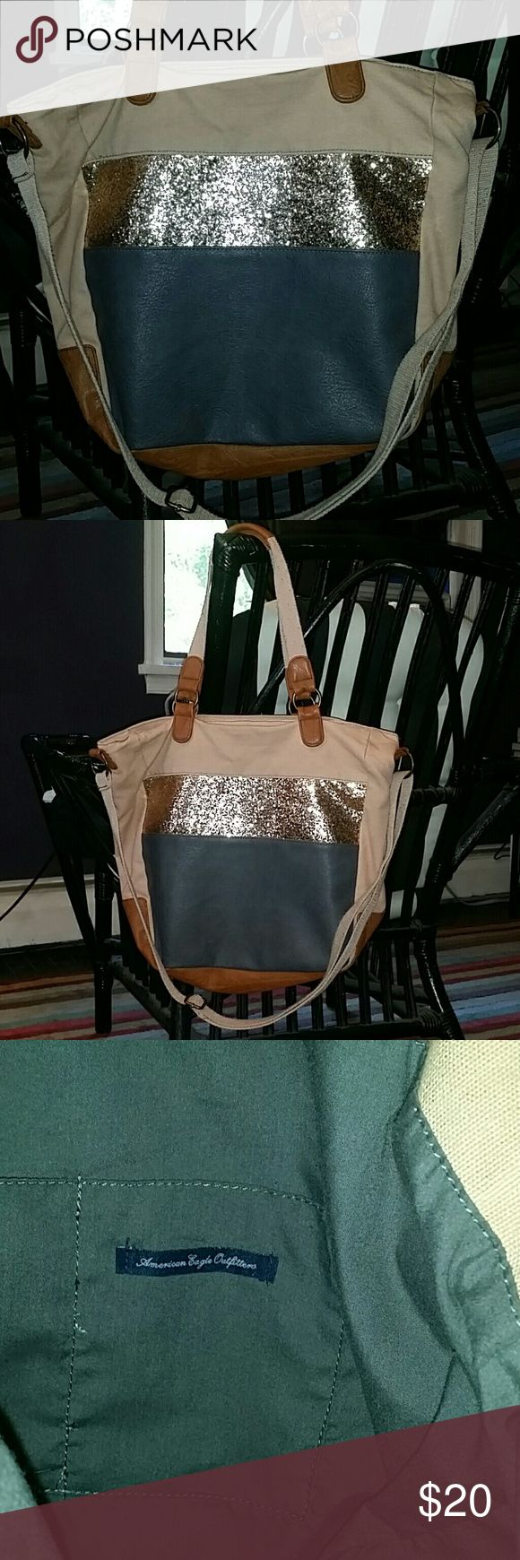 American Eagle AEO Sequin Tote Bag American Eagle Tote, Leather, Canvas, & Sequin, Tan canvas, grey & brown leather, with Gold sequin, has adjustable cross body strap, used very lightly, straps have some piling but could easily be removed, great bag for everyday or traveling! American Eagle Outfitters Bags Totes