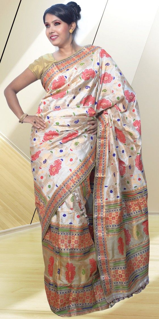 Beautiful Cream colour Pat Muga Tassar Mekhla Chadar with artistic Guna and Suta work of small and big buta giving a complete traditional look to the piece. The Mekhla Chadar comes with matching blouse piece, the blouse shown in the image is just for display purpose.Slight colour variation may be there in display & acutal.
