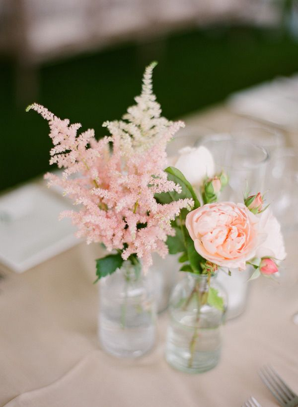 simple vases along tables but with bright colors
