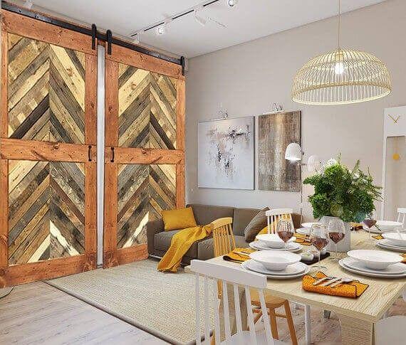 Das Chevron-Muster der diese doppelte Scheune-Schiebe-Türen werden erstellt, mit verschiedenen Farben und Texturen, was zu einer schönen modernen Version der rustikalen Türen.