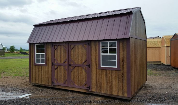 Grandview Buildings 10x16 Side Lofted Barn.  Burgandy metal roof with matching trim.  LP Smartside siding with Haley Chestnut stain.  Ridgevent.  Double wood doors and 2 windows.  Minnesota Made.  Minnesota Owned.  Minnesota Nice!