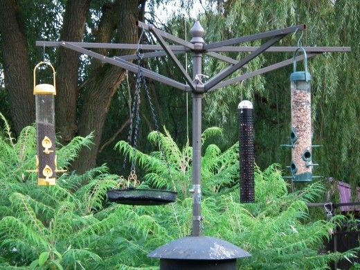 Bird feeding station made out of an old patio umbrella.