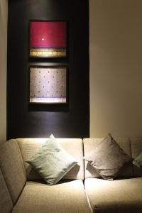 Framed sarees used as a focal piece of art in the living room!