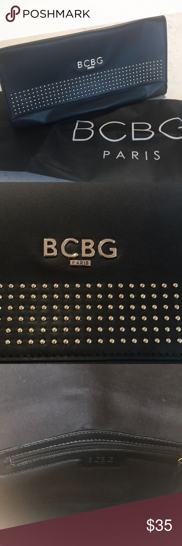 BCBG black studded clutch purse Black leather clutch with gold studs. Great condition. Used only once!!! BCBG Bags Clutches & Wristlets