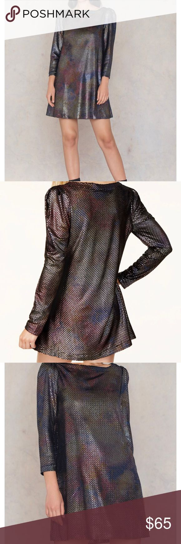 Free people diamonds are forever cute mini dress Shine on in this long sleeve metallic mini dress featuring structured shoulders and a swingy silhouette. Side pockets Hand wash  Length: 33 in Sleeve Length: 21.5 in Free People Dresses Mini