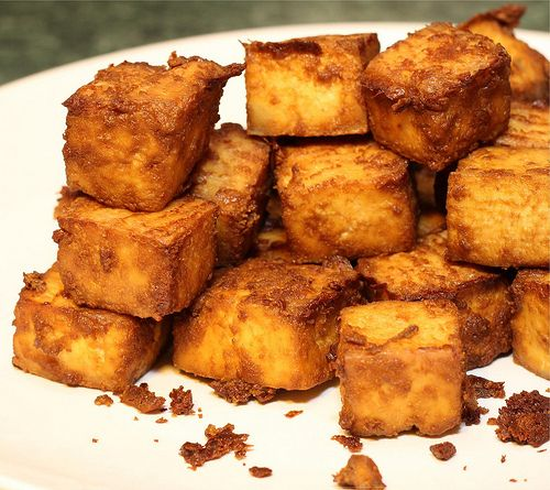 Baked Tofu with coconut oil, nutritional yeast and soy sauce. YUM!  Try this - so yummy - tastes sort of like fried chicken!