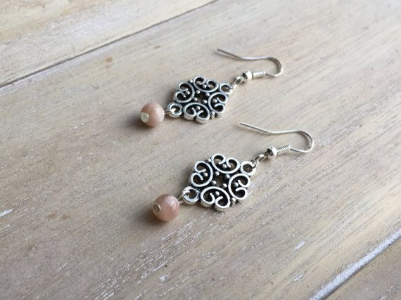 Antique silver dangle earrings, filigree with sunstone bead.