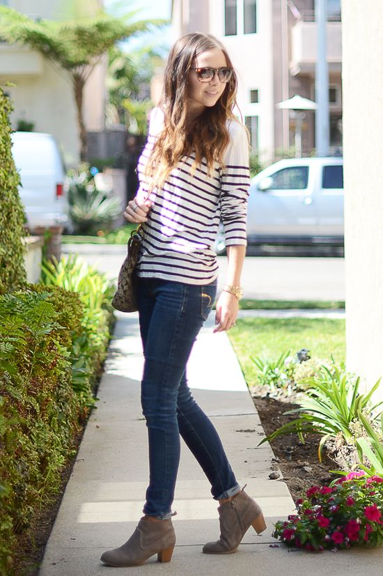 One of my favorite looks when pairing jeans with booties is the half cuff. It's an effortless look and is fun when paired with an oversized tee and sunglasses for a weekend with friends. Tip #4: To make this look as effortless as possible, don't make your half cuffs match. Keep them about the same height, but roll/cuff them at slightly different angles and widths to make them look effortless and a little haphazard.: