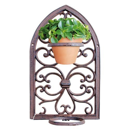 This decorative Plant Pot Holder is a beautiful way to display plants in the garden. Attach them to a wall or fence to create a traditional rustic background for foliage and flowers.  http://www.english-heritageshop.org.uk/garden/plant-gifts/gothic-window-frame-pot-holder