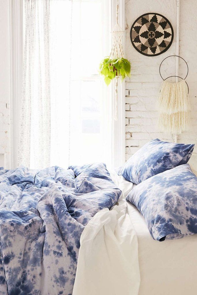 Drift off underneath this cool cotton duvet, which has been hand-dyed. The serene bedding set includes a duvet cover and a matching pillow sham, each one individually dyed with a unique pattern. Toget