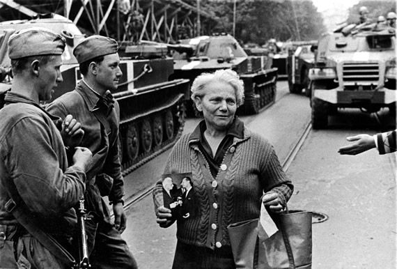 A World to Win   Resources   The Prague Spring - beginning of the end for StalinismWoman with a portrait of President Ludvik Svoboda and Alexander Dubcek, Prague 1968  © Archives of Alena Sourkova