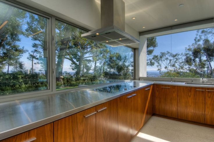 Amazing Green Trees View From The Wide Glass Walls In The Lookout Residence Kitchen With Wooden Cabinets