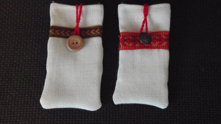 Mobile phone pockets made out of Finnish folk costume materials.  @http://www.facebook.com/Kansanomaisetkankaat