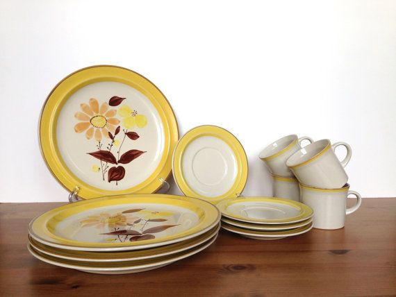 """Beautiful set of ji Stonecrest dinnerware. Designed by Andre Ponche, this handprinted collection is pattern called Sunflower number #225. 12 pieces total: 4 dinner plates, 4 saucers and 4 mugs. Perfect for a light lunch or dinner. Gorgeous yellow and brown trim on off-white ground. Flowers decorate the surface of the dinner plates. Very good vintage condition with no chips, cracks or damage.  Dinner plate: 10 3/4 across  Saucer: 6 1/4"""" across  Mug: 3"""" tall x 3 ¼"""" wide  I gently clea..."""