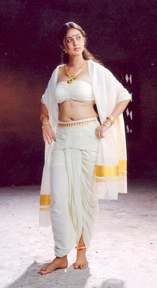 Actress Kanika in mundu and mulakkacha like dress.