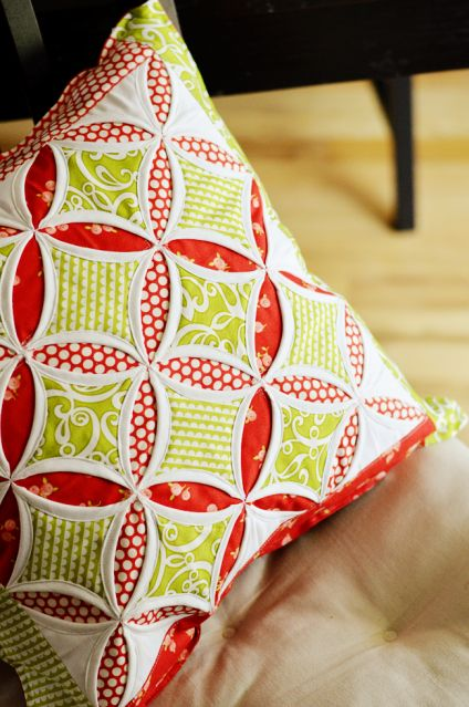 Cathedral Window Cushion.  Great use of fabric.