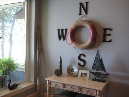 Lake cabin decor, add to the ceiling, with the light in the middle of the tube!  Could make easily with foam wreath, spray paint, and twine or rope! It would be easier to mount to ceiling that way also