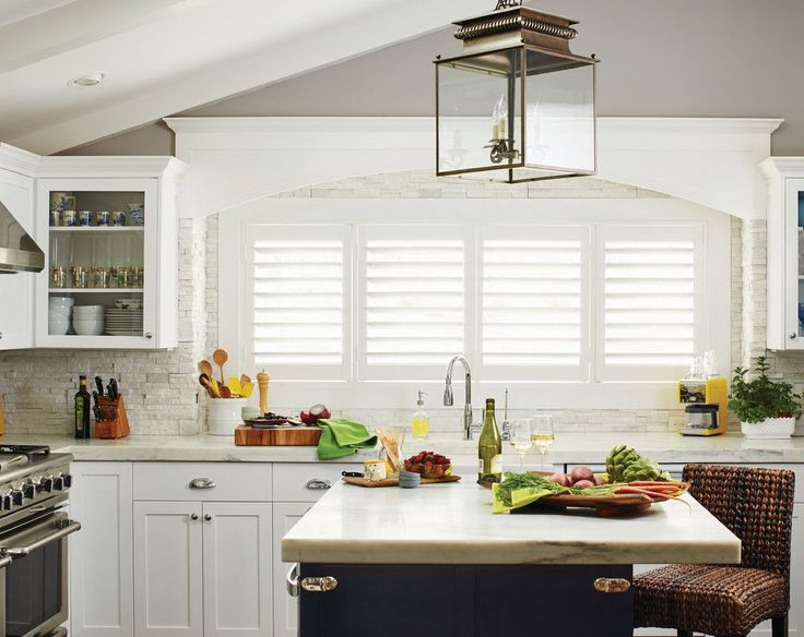 Waterfall Countertop For A Contemporary Kitchen With A Kitchen Island  Lighting And White Plantation Shutters For