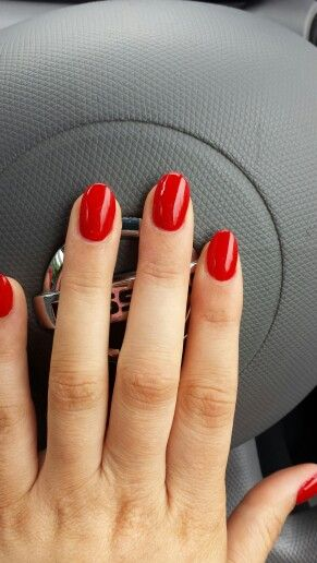 Red acrylic nails. Pretty.