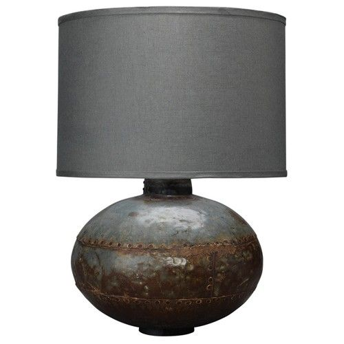 "The Caisson Table Lamp is part of the Jamie Young Collection. This collection is full of wonderful eclectic designs that have been developed using inspiration from world travel and discovery of ancient art forms. Jamie Young has a great niche for what is current without being trendy. They are constantly pushing the envelope with new materials, new designs and new categories for living every day in style.  Finish: Gun Metal Base: 11.5""h Footprint: 6""dia.  Shade: Classic drum in fatigue ..."