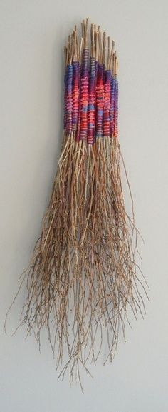 This could be an awesome recycling (yarn) and garden (dried plants) project.